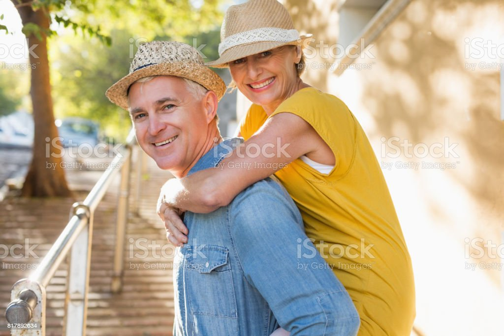 Happy mature couple having fun in the city stock photo