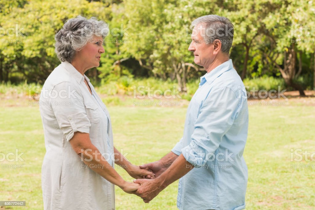 Happy mature couple in park stock photo
