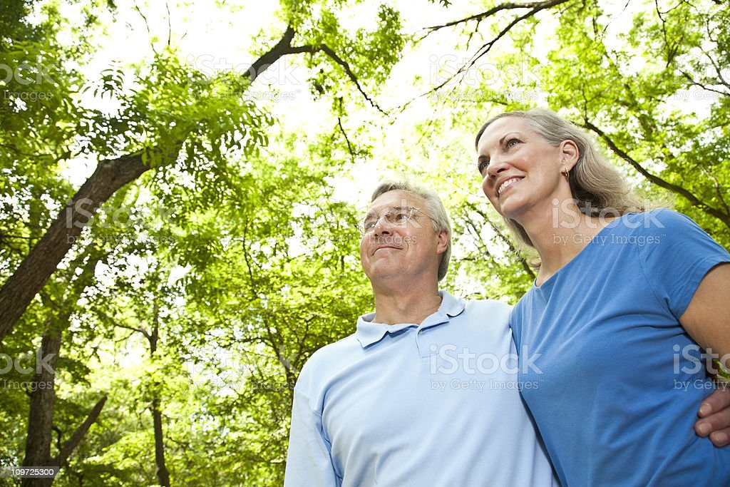 Happy Mature Couple in the Woods Looking Forward royalty-free stock photo