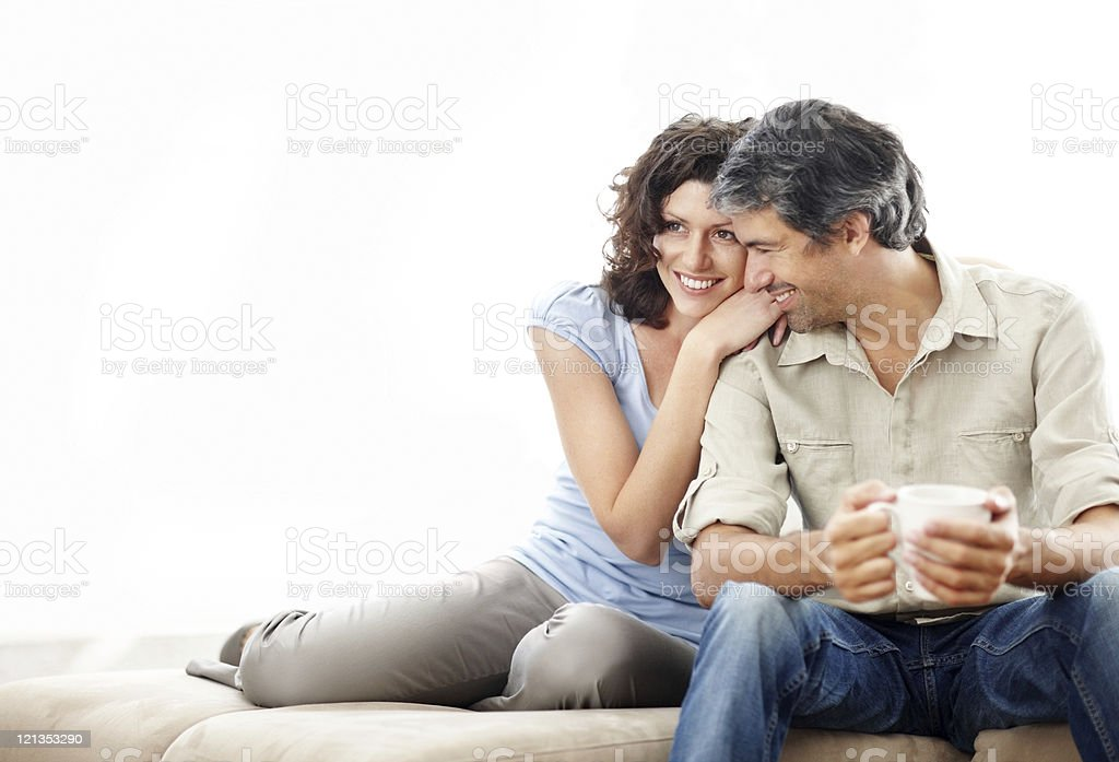 Happy mature couple on couch stock photo