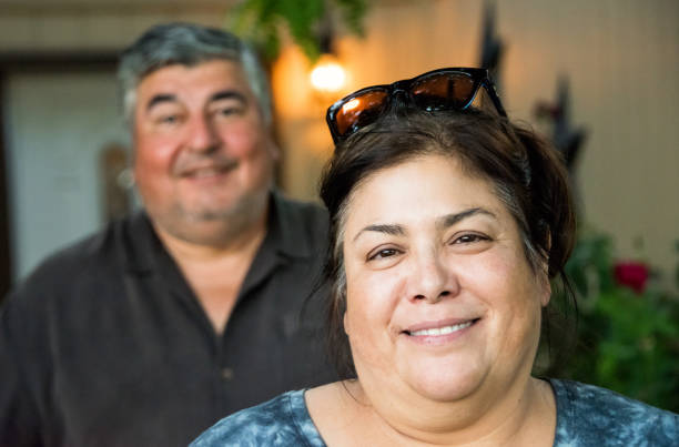 happy mature couple happy mature couple posing looking at the camera armenian ethnicity stock pictures, royalty-free photos & images