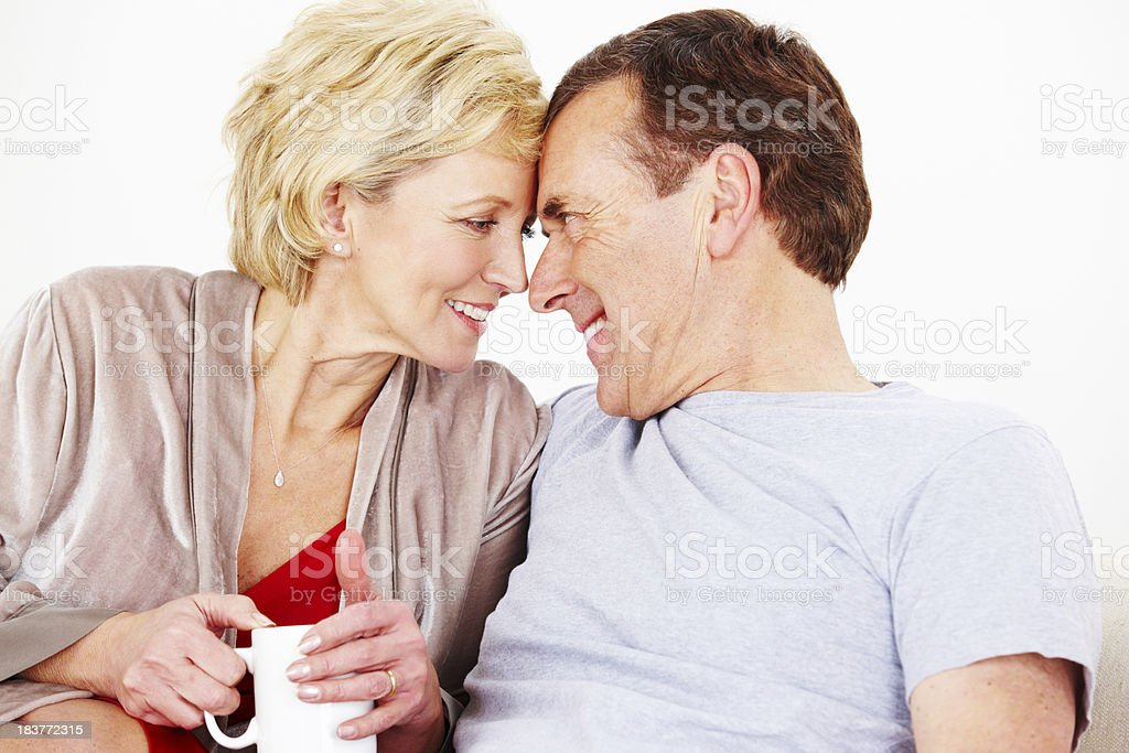 Happy mature couple relaxing in lounge royalty-free stock photo