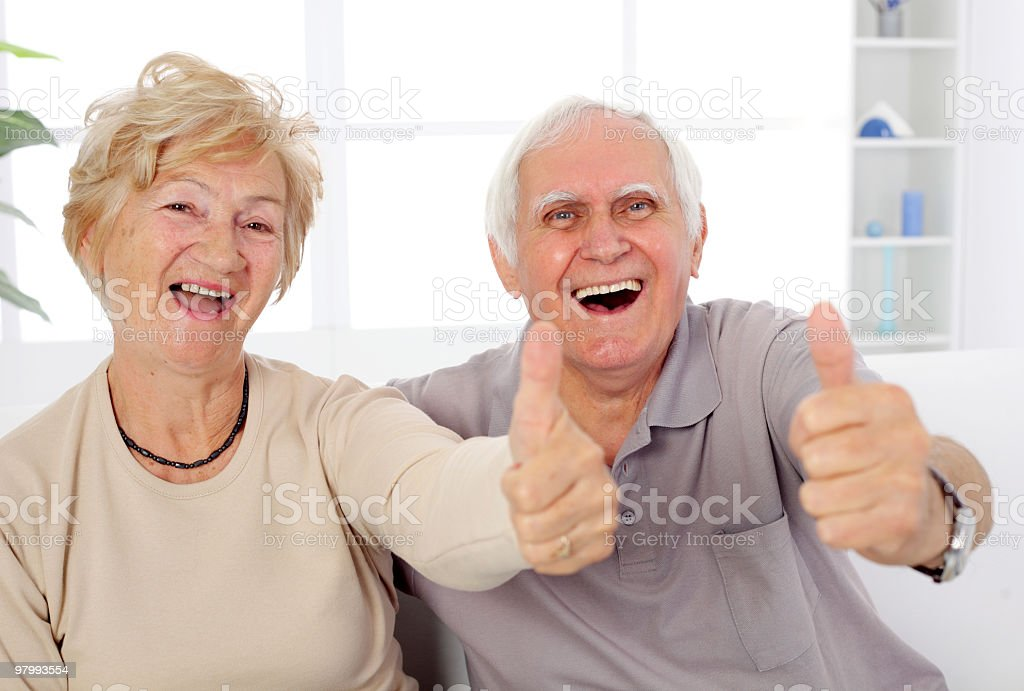 Happy mature couple showing ok. royalty free stockfoto