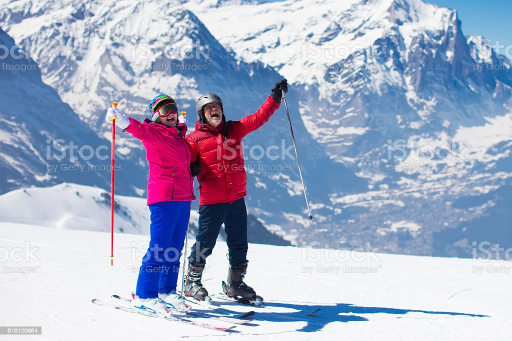 Happy mature couple skiing in the mountains – Foto