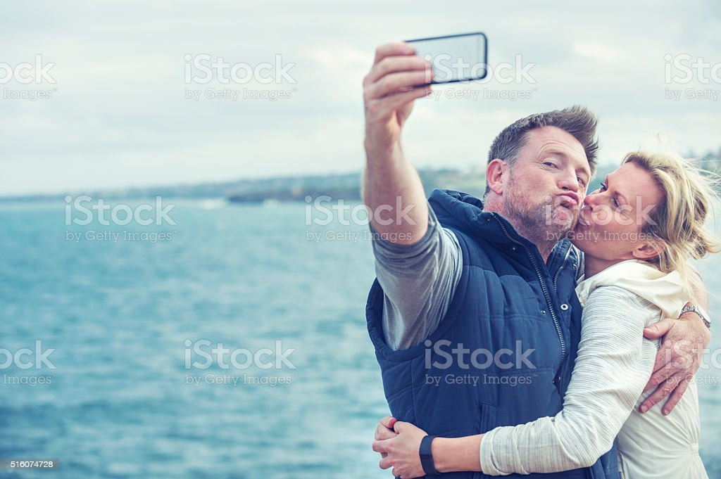 Happy mature couple taking a selfie. stock photo