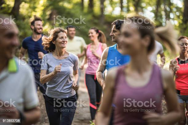 Happy mature couple talking while running a marathon race through picture id912853708?b=1&k=6&m=912853708&s=612x612&h=h5uxtfmp4mlcbmokqfm3ffe4bzoaz8yzlafxgc4 sma=