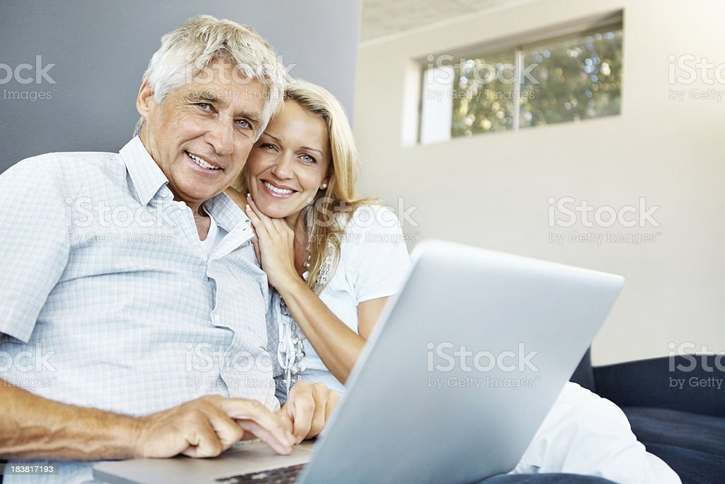 Happy, mature couple using a laptop royalty-free stock photo