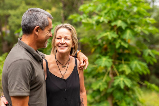 Happy Mature Couple Walking Together by a River stock photo