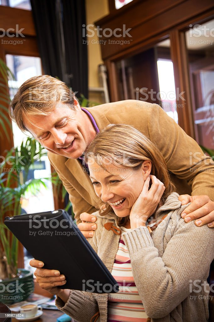 happy mature couple with computer tablet royalty-free stock photo