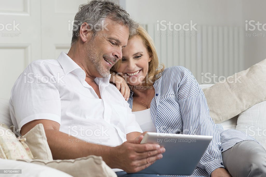 Happy Mature Couple With Tablet stock photo