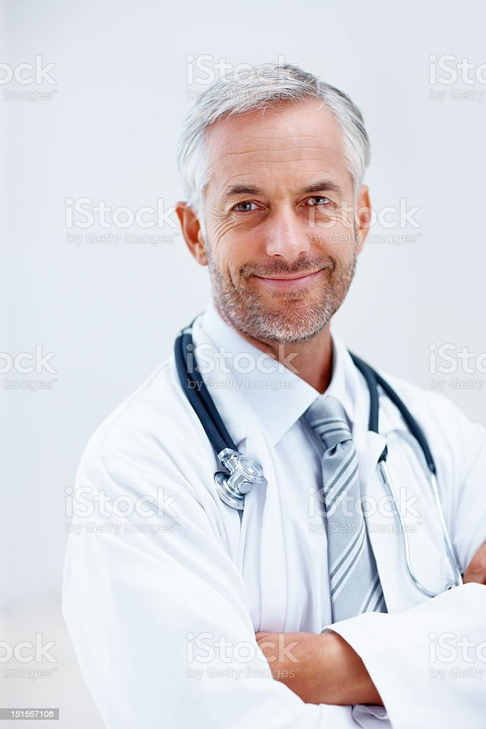 Happy mature doctor with his arms crossed royalty-free stock photo
