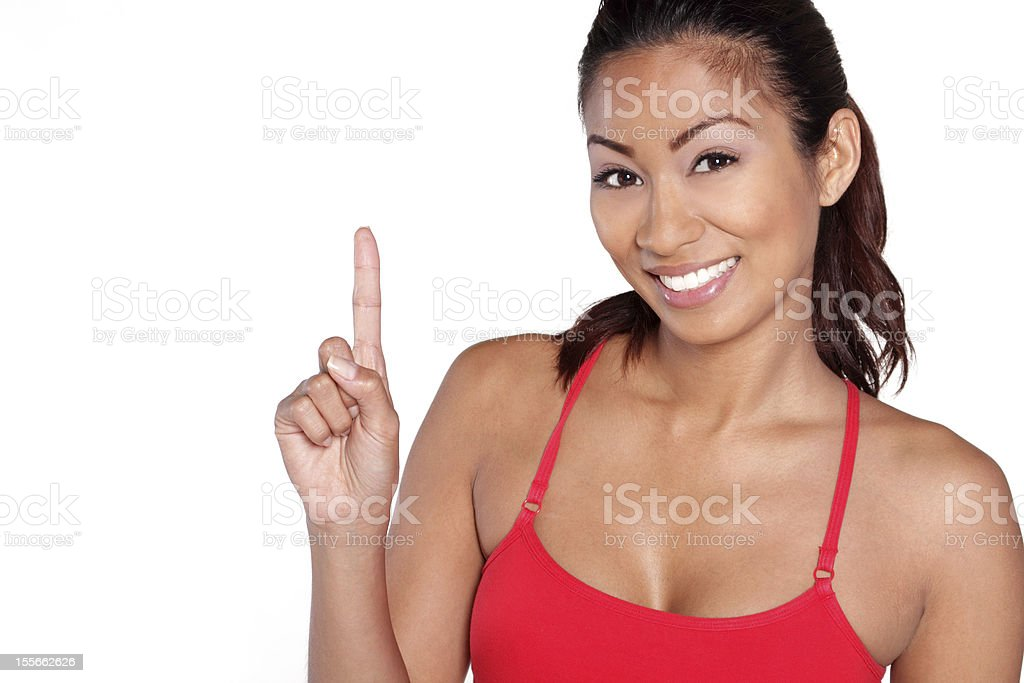 Happy mature fitness woman with number one hand sign stock photo