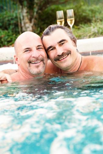 Happy Mature Gay Men In Hot Tub Portrait Stock Photo