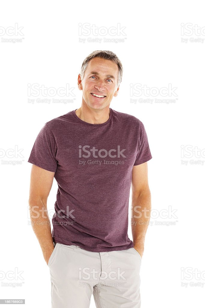Happy mature guy standing relaxed on white stock photo