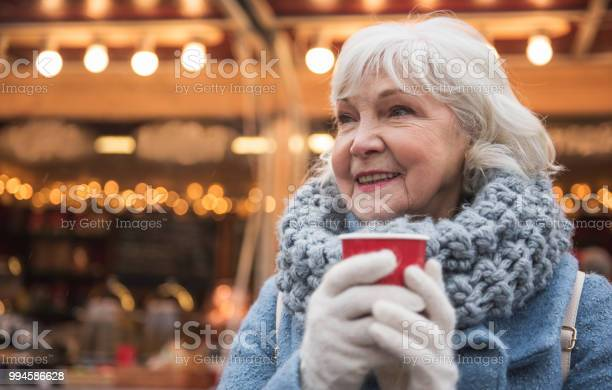 Happy mature lady warming up by hot beverage outdoor picture id994586628?b=1&k=6&m=994586628&s=612x612&h=fy23aduohxzac5xd1biuyv u0bfcnqz9scmuazuiz s=