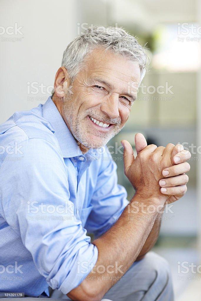 Happy mature male entrepreneur smiling royalty-free stock photo