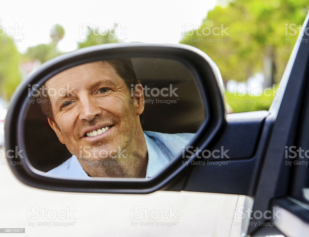 Happy Mature Man in a car mirror portrait royalty-free stock photo