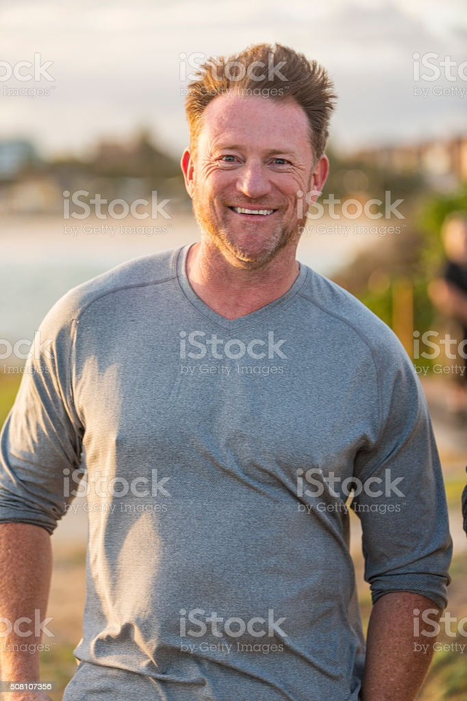 Happy Mature Man Jogger By the Seaside After Exercising stock photo