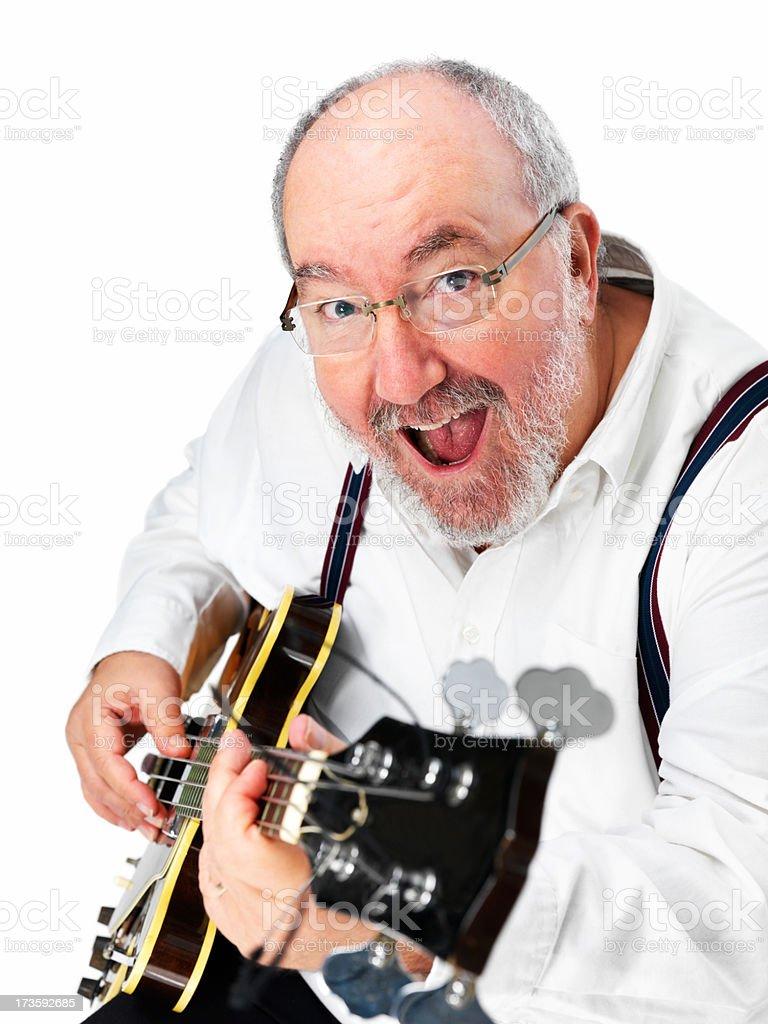 Happy mature man playing guitar royalty-free stock photo
