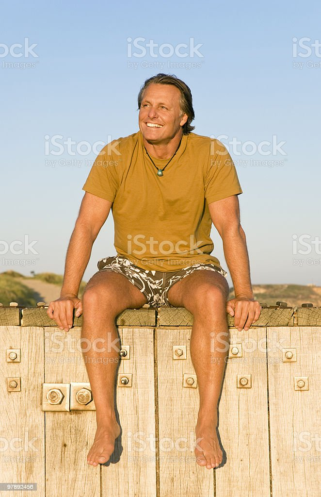 happy mature man sitting in the sun. royalty-free stock photo