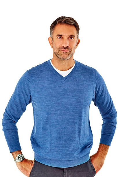 Happy mature man standing casually stock photo