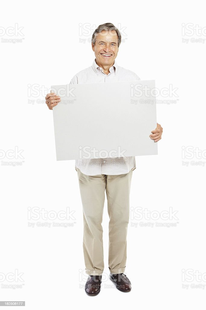 Happy mature man with a blank signboard isolated on white royalty-free stock photo
