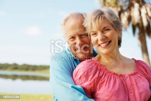 510491454 istock photo Happy, mature man with arms around his wife 182042239