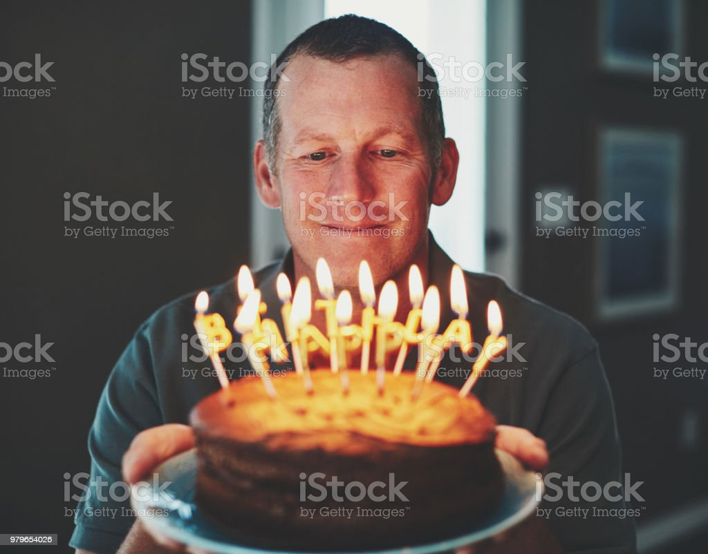 Happy Mature Man With Birthday Cake Stock Photo More Pictures Of
