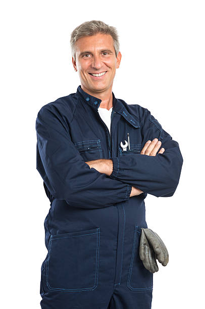 Happy Mature Mechanic Portrait Of Confident Mature Mechanic In Overalls With Arm Crossed Looking At Camera Isolated On White Background mechanic stock pictures, royalty-free photos & images