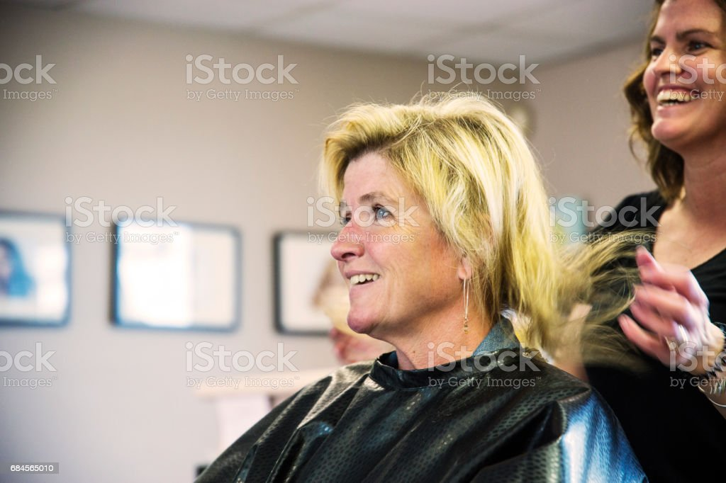 Happy Mature Middleaged Woman In A Hair Salon Discussing Her Hair
