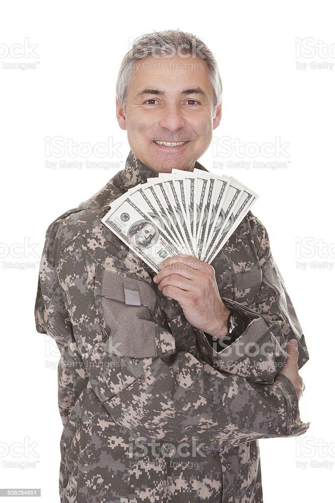 Happy Mature Soldier Holding 100 Dollar Bills royalty-free stock photo
