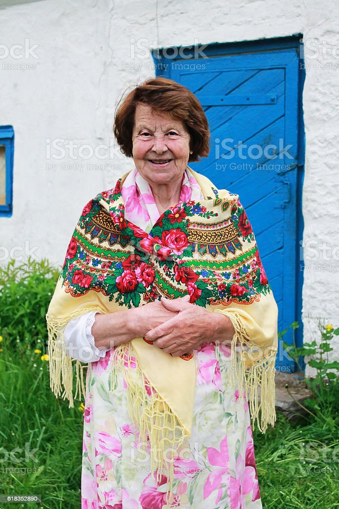 Happy Mature Woman by the Country House stock photo
