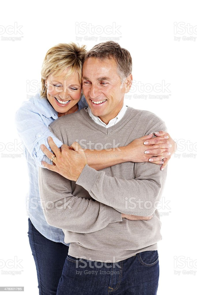 Happy mature woman embracing her husband from behind royalty-free stock photo