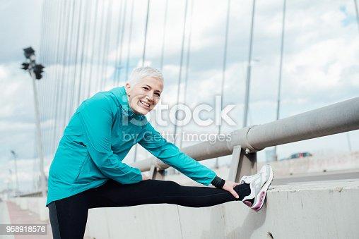 istock Happy mature woman exercising 958918576