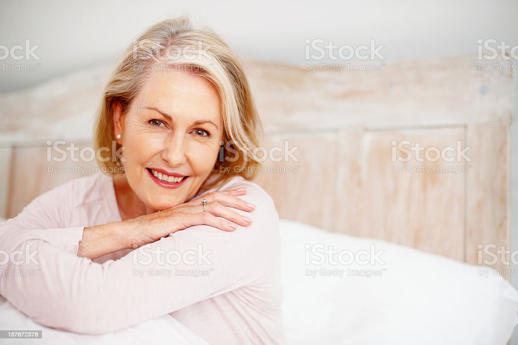 Happy mature woman giving you a cute smile royalty-free stock photo