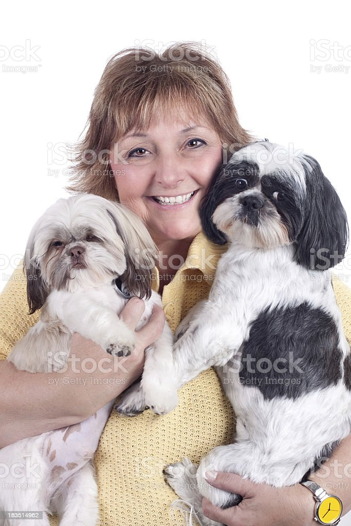 Happy Mature Woman Holding Two Pet Dogs royalty-free stock photo