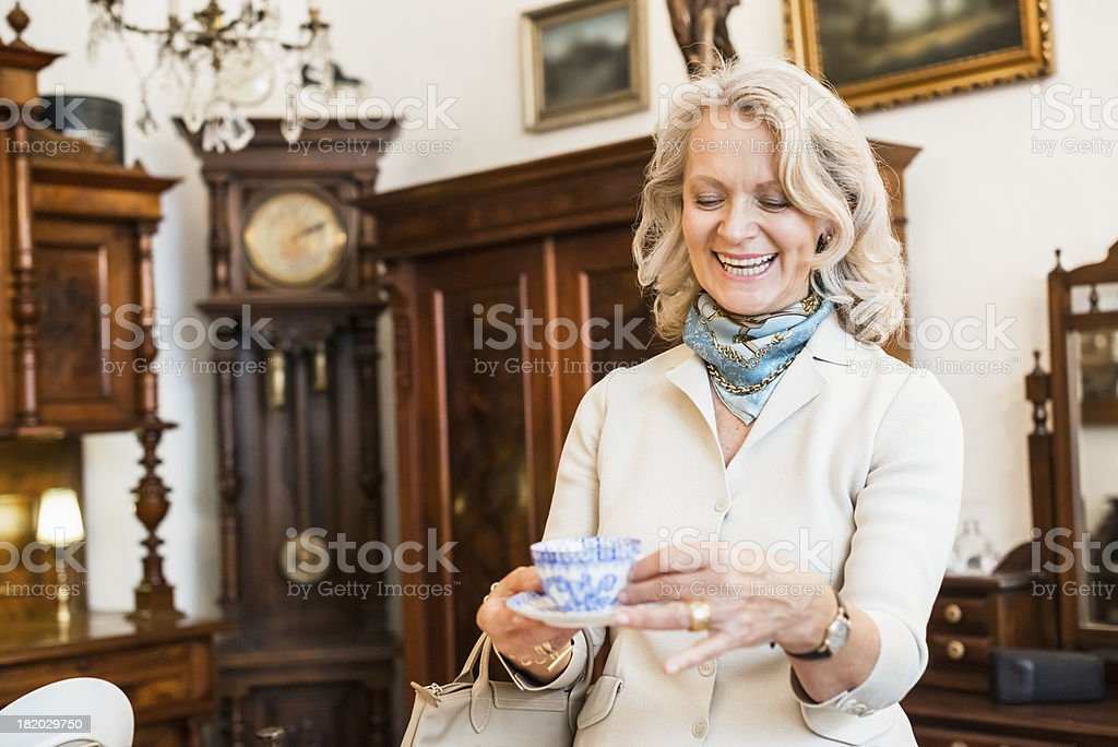 Happy Mature Woman in Antique Store stock photo