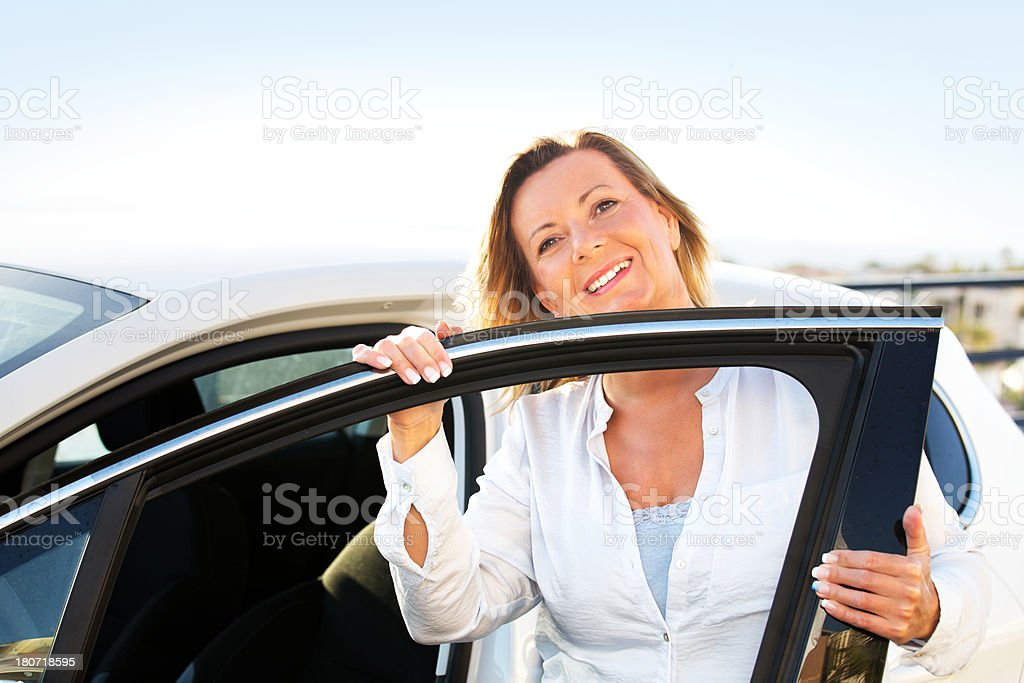 Happy mature woman in her car royalty-free stock photo