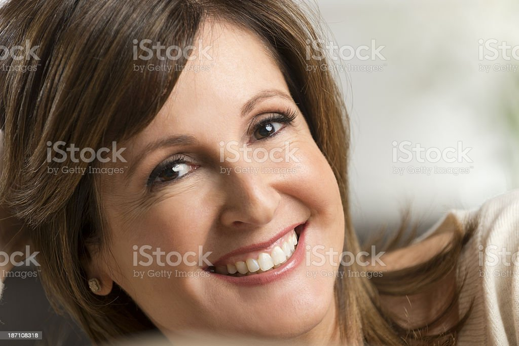 Happy mature woman indoors royalty-free stock photo