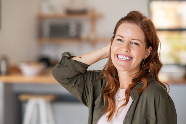 Happy mature woman laughing stock photo