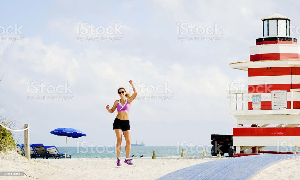 Happy Mature woman on the beach royalty-free stock photo
