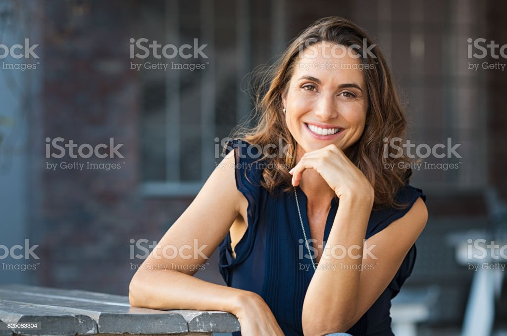 Happy mature woman outdoor stock photo
