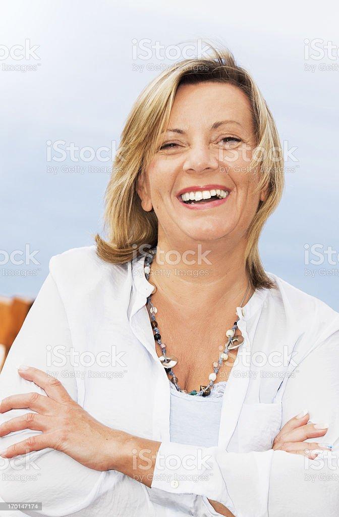 Happy mature woman outdoor portrait stock photo