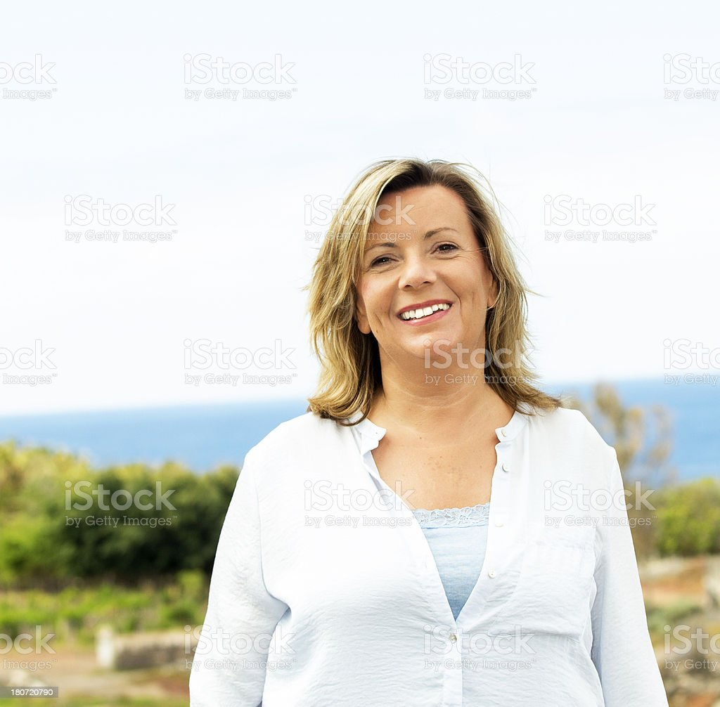 Happy mature woman outdoor portrait royalty-free stock photo