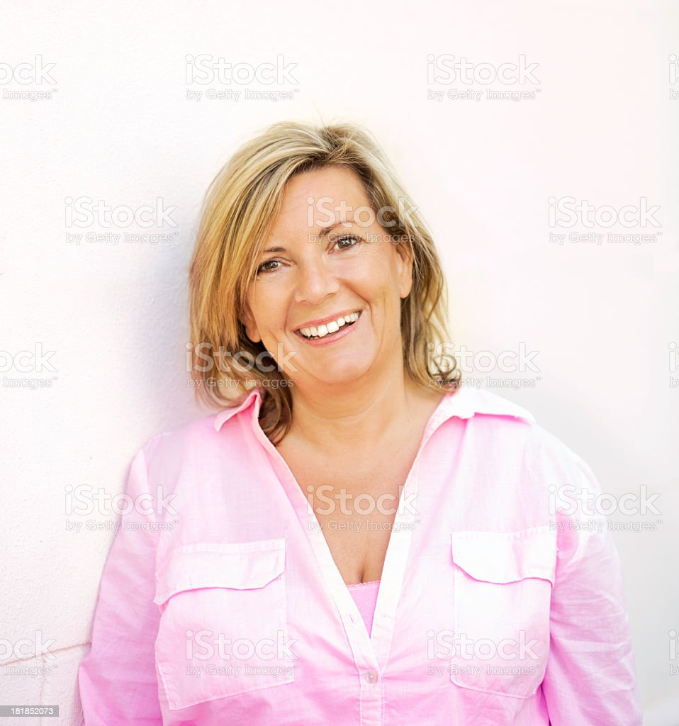 Happy mature woman outdoor portrait stock photo