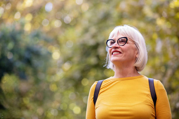 Happy Mature Woman Outdoors stock photo