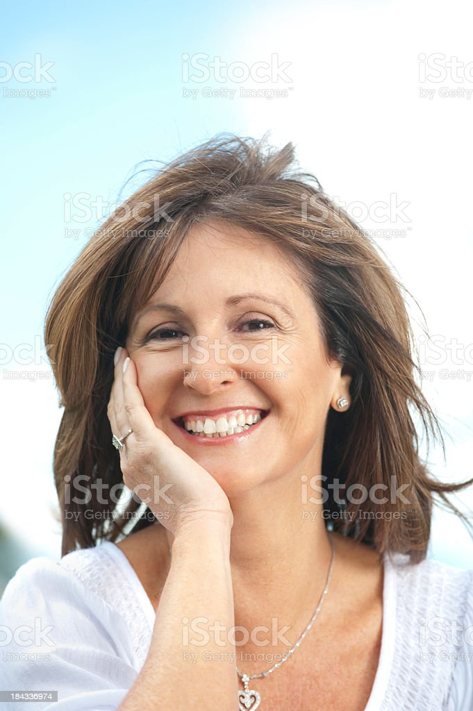 Happy mature woman outdoors royalty-free stock photo