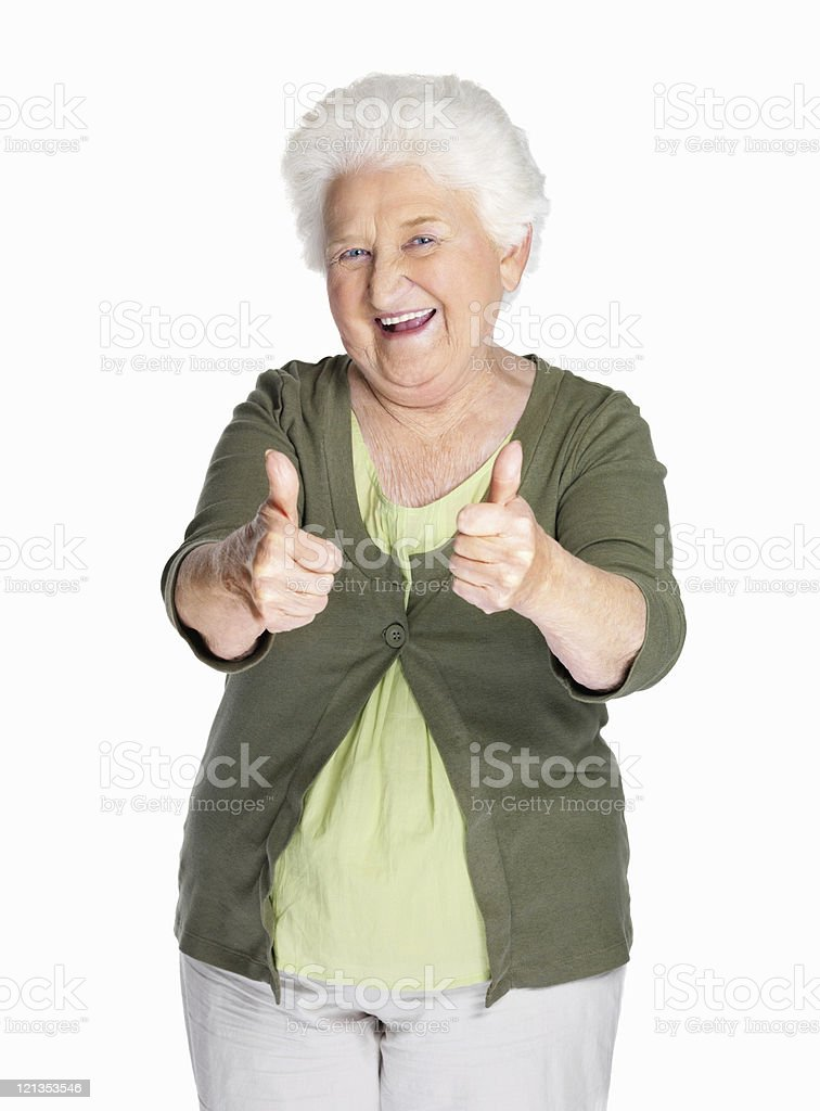 Happy mature woman showing thumbs up royalty-free stock photo