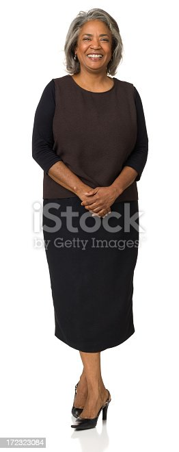 1173001813istockphoto Happy Mature Woman Standing Full Length Portrait 172323084