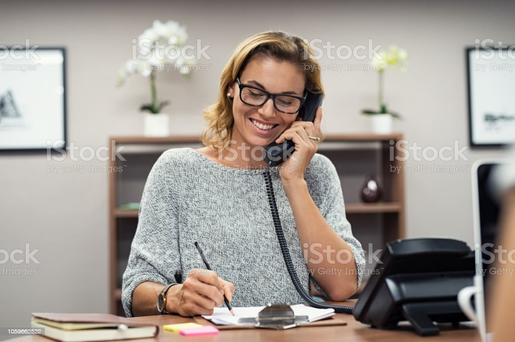 Happy mature woman talking on phone royalty-free stock photo